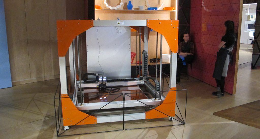 This industrial 3D printer can print out furniture. It's the future of 3D printing and manufacturing. It's amazing what 3D printing can do to a company's inventory costs.